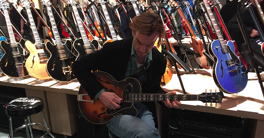 The Gibson Guitar Booth: Dave Bagley Sampling the Wares, NAMM 2019